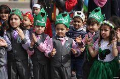 GAZA CITY, GAZA- Children enjoying the entertainment on show during the Palestine Children's Festival
