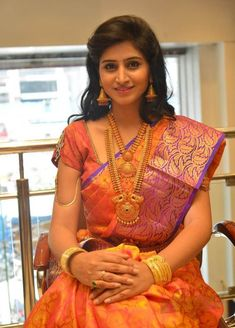Pretty bride with elegant yellow musk with pink silk saree enhanced beauty of the yellow body with rich contrast pink tissue border merges well and brings the bride saree in to rich traditional touch.