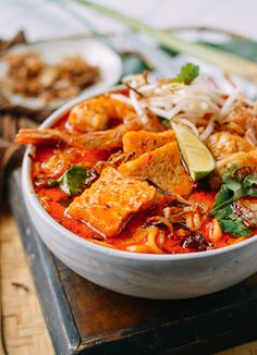 Laksa is spicy, fragrant noodle soup found across Southeast Asia. Our recipe doesn't shy away from strong, authentic flavors while also being easy to make. Asian Desserts, Asian Recipes, Ethnic Recipes, Laksa Recipe, Laksa Soup Recipes, Curry Laksa, Malaysian Food, Malaysian Recipes, Wok Of Life