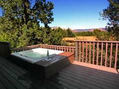 Sit in the hot tub and enjoy your stay at this lovely 2 bedroom West Sedona vacation rental. www.redrockrealty.net/homes.html