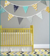 This colorful nautical themed bunting banner is the perfect addition to your baby boy's nursery, playroom or bedroom! Hang on the wall or across the room. Each bunting flag is double sided and strung with end loops for easy hanging. --- Bunting is crafted by featured maker {Carly Norton} in Massachusetts and 15% of profits goes to The Ellie Fund. #madeinusa #madeinmassachusetts