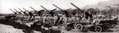 Italian motorcycle corps photographed behind reserve batterie