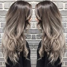 This grey & silver style is stunning! Beautifully blended and finished with tousled curls #silverhair #grey #curls