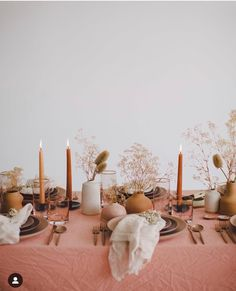 Blush tones and neutral flowers with taupe candles towards this table . - Blush tones and neutral flowers with taupe candles against this table decoration -
