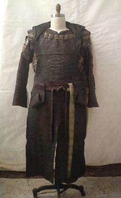Tubal-cain Principle Costume. Printed leather apron, graphite burnished leather tunic, mud cloth cape with dyed horse hair, distressing incomplete. Noah. Matt Reitsma, Head Textile Artist.  Michael Wilkinson, Costume Designer. - Tyranny of Style