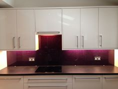 """CreoGlass Exclusive Design """"Purple Haze"""" the absolute No 1 seller. This hand made design using propitiatory process of applying raw materials onto the back of any thickness of glass creating beautiful deep purple shimmering structure you can't not notice. With starting price at £400 per square meter, Purple Haze Designer Splashback is part of CreoGlass Luxury Edition. Please visit the website for more stunning Kitchen Splashback Collections. www.creoglass.co.uk"""