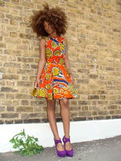 Its African inspired. The hair, the colors of the dress just beautiful