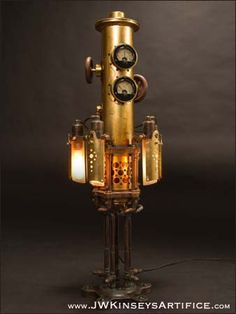 This lamp has two modes of illumination: one is general task lighting, the other is a night light. The round knobs at the top of the primary light body are the rotary control switches, and they are integrated with the functional panel meters. The Mystarium is not found object, or assemblage art. Rather, every part is hand-made for its specific application within the overall design (other than the obvious screws, nuts, assorted fittings, and modified panel meters): there are over 370 parts…