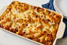 This easy baked ziti is filled with ground beef, a tomato-based sauce, and layers of melted mozzarella cheese. Here are tips and variations. Cheese Recipes, Pasta Recipes, Beef Recipes, Turkey Recipes, Dinner Recipes, Beef Dishes, Pasta Dishes, Ground Beef Pasta, Easy Baked Ziti