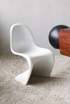 Designed by Dutch designer Verner Panton in 1959. The Panton chair is made from a single material and a piece of injection-moulded plastic.
