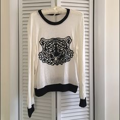 Tiger sweater by Moon Collection Adorable creme sweater with black tiger decal. Super comfy and fashionable! Other sizes are available for purchase-pleads see other listings! Moon Collection Sweaters Crew & Scoop Necks