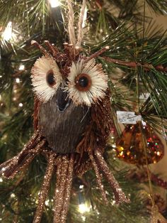 This sparkly owl adds a whimsical touch to a classic tree.