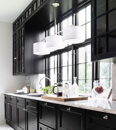Black and white kitchen that is modern and classic