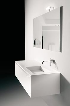 PANTA REI Top with integrated Corian sink 12 mm thick and bevelled on 3 sides, with drainage prepared for siphons art. MICRO or art. PLUS.  MATERIA Top with double integrated sink completely in Co…