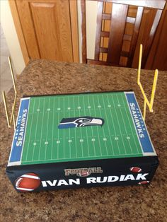 Football field Valentine box. Ashton wants this one for his class but done in Dallas COWBOYS