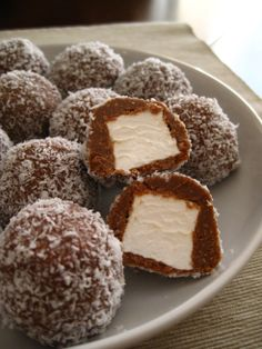 Ingredients: 7oz butter 14oz sweetened condensed milk 7oz firmly packed brown sugar 1oz cocoa powder (sifted) 1/2 tsp vanilla essence 13oz plain sweet biscuit crumbs 11oz marshmallows 4.75oz desiccated coconut