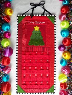 Advent Calendar - Quilted Christmas Tree in Holiday Red and Emerald Green - Countdown to Christmas. $75.00, via Etsy.