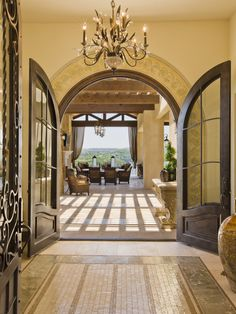 Entry - I like round doors, double doors thrown open for parties, front doors that open right into welcoming family/living room & a chandelier for entryway light is great!