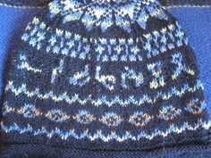 Free Knitting Pattern for Stargate Hat - This SG Fair Isle hat by Carol Schoenfelder features glyphs from the tv series.