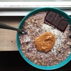 Morning  here is my delish breakfast from today. Blueberry banana oats with shredded coconut, 3 85% dark chocolate squares, and a big ole dollop of peanut butter. Big mug of black coffee on the side #Padgram