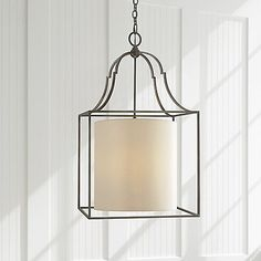 The Visual Comfort Gustavian Lantern Pendant is a blend of modern and traditional styles. A simple round paper shade is encased in an open metal frame, which is accented with appealing baroque curves near the top. Straightforward with enticing details, this ceiling light will illuminate your space with a contemporary spin on classic style.