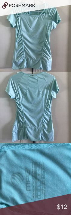 MPG Sports Gear  sea green top It is preowned, excellent condition sea green top. Great for running and sports activity. It has pocket with zip to keep belongings as shown in picture. MPG Tops