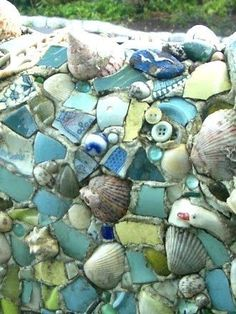 DIY Mosaic with shells. Love this idea for the garden. Would make use of all…