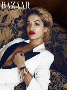 Rita Ora in  Maison Martin Margiela jewels styled with her Alexander McQueen black-and-white tuxedo