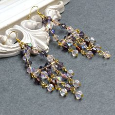 Long Crystal Chandelier Earrings. Perfect idea for all the crystal beads I have.