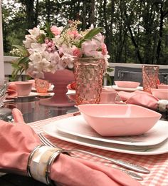 """Table set with """"Pink Hyacinth"""" Melmac dinnerware from 1956."""