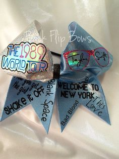 Taylor Swift World Tour cheer bow! Names of a few of her most popular tunes on the tails in black glitter. Pearlescent shimmer sunglasses &