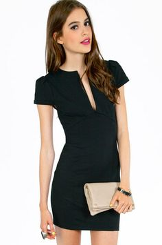 black dress + nude clutch.
