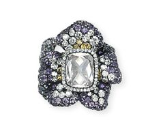 A Diamond and Amethyst 'Three Violets' Ring, by JAR Designed as three violet flowerheads pavé-set with amethysts, diamonds and yellow diamonds, the central flower centering upon an old-cut cushion-shaped diamond, weighing approximately 2.50 carats, mounted in silver and gold, 2002