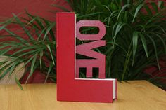 Upcycle an old book into an ornamental letter of love.