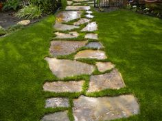 Creating this walkway to pass under the trellis and along the flower garden. Then it will meet up with the patio.