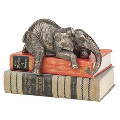 Artfully hand-finished, this charming elephant statuette adds a whimsical touch to stacked books and magazines | $32.95