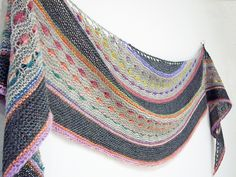 Jewel is a soft crescent shaped shawl that uses a long colour change yarn to adorn the shawl with jewels of colour.