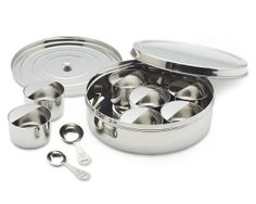 Stainless-Steel Spice Box W/Spoons: Modeled on traditional Indian masala dabba (spice box), stainless steel tin has a large, round container comes w/7 removable spice bowls w/built-in leveler & 1T & 1t.  Smart design keeps spices organized by cuisine. double lid keeps spices fresh. 2 make accurate measuring easy - half-moon 'catch' for leveling measuring spoons is built into every small bowl. Holds different essential spice that enables focus on cooking
