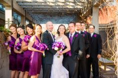 A May bridal party in purples & white.