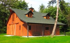 small horse barn with loft, overhang on one side, cupola, and dormers