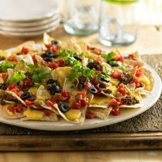 Ultimate Nachos: Nacho recipe with toppings of ground beef, lettuce, olives and zesty tomatoes for the ultimate snack. Velveeta® is a registered trademark of Kraft Foods, Inc. Ro*Tel® is a registered trademark of ConAgra Foods RDM, Inc. Great Appetizers, Appetizer Recipes, Snack Recipes, Dinner Recipes, Cooking Recipes, Recipes With Velveeta Cheese, Nacho Cheese, Cheese Recipes, Hors D'oeuvres