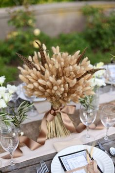 a wheat and feather wedding centerpiece will fit both a boho and a rustic wedding - Weddingomania Wheat Centerpieces, Thanksgiving Centerpieces, Wedding Centerpieces, Wedding Decorations, Wheat Decorations, Chic Wedding, Fall Wedding, Rustic Wedding, Trendy Wedding