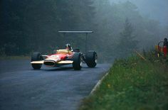 "Graham Hill passes ""Kesselchen"" during the German Grand Prix 1968 at the Nurburgring.                                                                                                                                                                                 More"