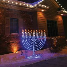 Lighted Menorah Candle