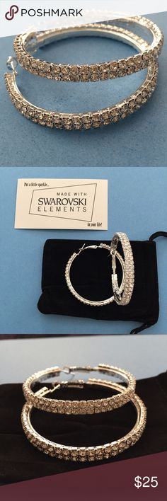 "NWT Swarovski Crystals in Hoop Earrings NWT Sterling Silver Double Row Hoop Earrings with Swarovski Crystals. These are Medium hoops about 2 1/2"" diameter. They look like they would be heavy but they are reasonable!...the metal isn't heavy. Jewelry Earrings"