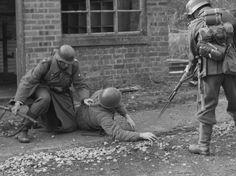 Grossdeutschland troops with a Russian prisoner
