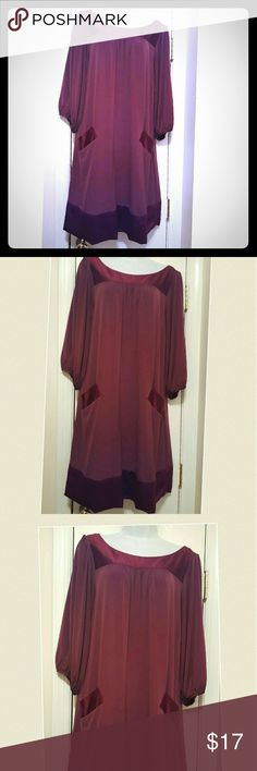 Beautiful Burgundy jersey knit romper dress Beautiful burgundy colored  jersey knit romper dress with satin trimmed  pockets on each side and  a satin trimmed high round neckline and satin trimmed hemline. Great for holiday dressing. Max & Cleo Dresses