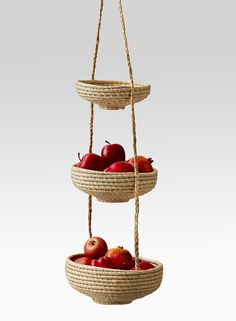 We're bringing the hanging basket back. We remember how a hanging basket with fruits, onions, or vegetables, was once a thing in many homes. Our version is handmade in Madagascar of natural raffia. Use it for household staples, but it can also be a great