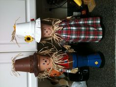 "OK, so I made those cute couple long before I had kiddos, like maybe 15 yrs ago, way before Pinterest. I pulled them out for my Fall decor and someone said ""Put that on Pinterest, Laura!"" So here ya go!   Mr an Mrs Scarecrow made out of clay pots!"