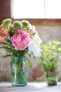 informal mixed flowers in mason jars